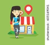 asian woman holding smartphone... | Shutterstock .eps vector #605169041