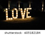the word love made with lights... | Shutterstock . vector #605182184