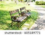 metal garden chair in the garden | Shutterstock . vector #605189771