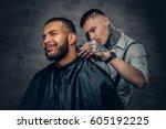 tattooed caucasian male barber... | Shutterstock . vector #605192225