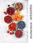 various fresh fruits in bowls... | Shutterstock . vector #605203901