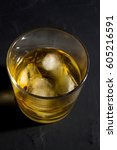 whiskey in a close up glass    Shutterstock . vector #605216591