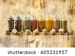 spices in jars on wooden... | Shutterstock . vector #605231957