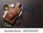 grilled ribeye beef steak ... | Shutterstock . vector #605232491