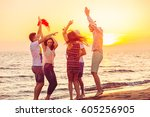 young people dancing on beach... | Shutterstock . vector #605256905