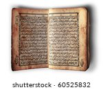 Open book in side of Al-Quran on white - stock photo