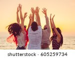 people dancing at the beach... | Shutterstock . vector #605259734