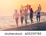 group of happy young people is... | Shutterstock . vector #605259785