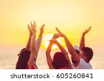 people dancing at the beach... | Shutterstock . vector #605260841