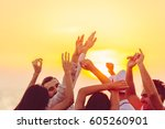 people dancing at the beach... | Shutterstock . vector #605260901