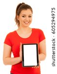 woman holding a tablet isolated ... | Shutterstock . vector #605294975