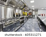 Stock photo modern shiny kitchen with stainless still kitchenware and equipment for restaurant scale cooking 605311271
