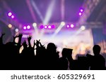 silhouette audience on blurred... | Shutterstock . vector #605329691