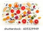 mixed fruits on a white wooden... | Shutterstock . vector #605329949