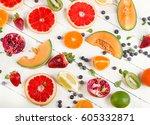 fresh mixed fruits on a wooden... | Shutterstock . vector #605332871