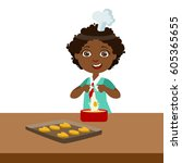 boy making dough for cookies ... | Shutterstock .eps vector #605365655