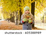 cute little girl walks in the... | Shutterstock . vector #605388989