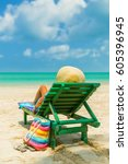 woman sitting on a deck chair... | Shutterstock . vector #605396945
