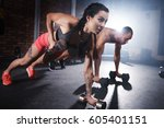 athletes lifting weights and... | Shutterstock . vector #605401151