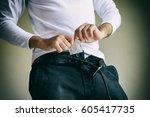 closeup of man having condom in ...   Shutterstock . vector #605417735