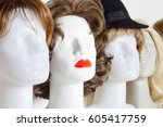 row of mannequin heads with... | Shutterstock . vector #605417759