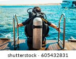 scuba diver before diving. a... | Shutterstock . vector #605432831