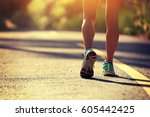 young fitness woman running on... | Shutterstock . vector #605442425