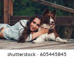 young woman with her border... | Shutterstock . vector #605445845