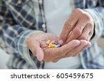senior man taking pills  closeup | Shutterstock . vector #605459675