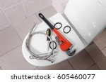 plumber's tools on toilet at... | Shutterstock . vector #605460077