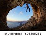 rock climber gripping handhold... | Shutterstock . vector #605505251