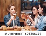 friendly girls having friday... | Shutterstock . vector #605506199