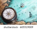 old compass on vintage map.... | Shutterstock . vector #605519009