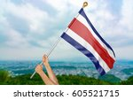 young man's hands proudly... | Shutterstock . vector #605521715