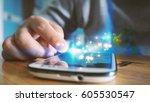 businessman touching smartphone. | Shutterstock . vector #605530547