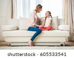 side view of happy mother... | Shutterstock . vector #605533541