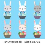 cute easter bunnies with eggs | Shutterstock .eps vector #605538731