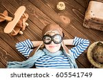 child pretend to be pilot. kid... | Shutterstock . vector #605541749