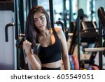 young asian woman training with ... | Shutterstock . vector #605549051