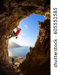 two male rock climbers in cave  ... | Shutterstock . vector #605552585