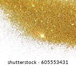 golden glitter sparkles on...