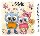 two cute cartoon owls on orange ...   Shutterstock .eps vector #605556314