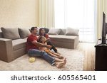 family sitting on floor... | Shutterstock . vector #605565401