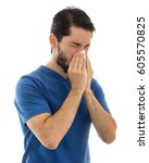 young adult cleaning his nose... | Shutterstock . vector #605570825
