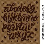 chocolate font on brown waffles ... | Shutterstock .eps vector #605588975