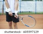 the man holds a tennis racket | Shutterstock . vector #605597129