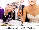 smiling newlyweds clang their... | Shutterstock . vector #605597885