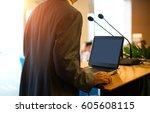 business man is making a speech ... | Shutterstock . vector #605608115