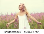 outdoor portrait of a beautiful ... | Shutterstock . vector #605614754