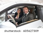 attractive couple chooses the...   Shutterstock . vector #605627309